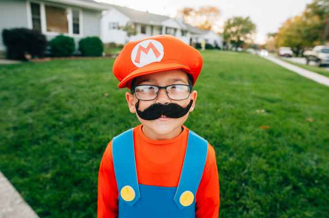 photo of boy in super mario costume