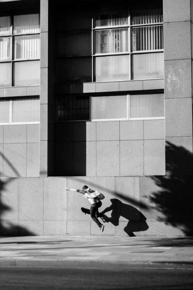 man skating near building