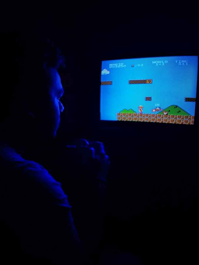 photo of man playing super mario bros